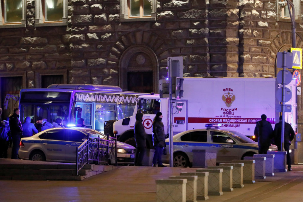 An ambulance is seen on the site of a shooting incident near the Federal Security Service (FSB) building in Moscow, Russia...