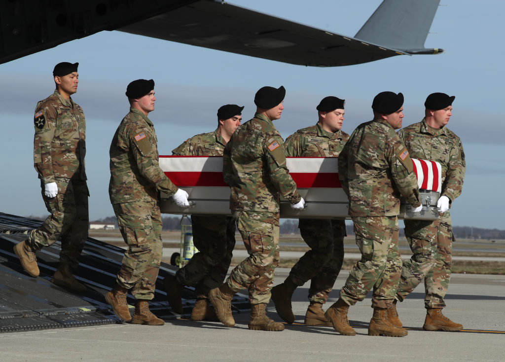 A U.S. Army carry team moves the transfer case containing the remains of U.S. Army Sgt. 1st Class Michael Goble during a d...