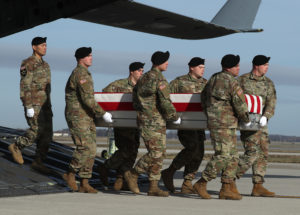 A U.S. Army carry team moves the transfer case containing the remains of U.S. Army Sgt. 1st Class Michael Goble during a dignified transfer at Dover Air Force Base, December 25, 2019 in Dover, Delaware. Sgt. Goble who was from Washington Township, N.J., was killed on December 23rd during combat in Afghanistan. Photo by Mark Wilson/Getty Images