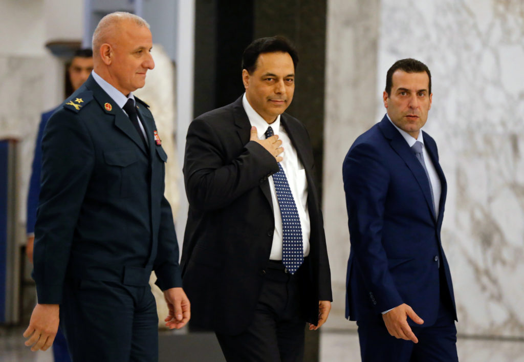 Hassan Diab, Lebanon's newly named prime minister, walks at the presidential palace in Baabda, Lebanon December 19, 2019. ...