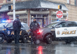 Jersey City police work at the scene the day after an hours-long gun battle with two assailants around a kosher market in Jersey City, New Jersey, U.S., December 11, 2019. Photo by REUTERS/Lloyd Mitchell