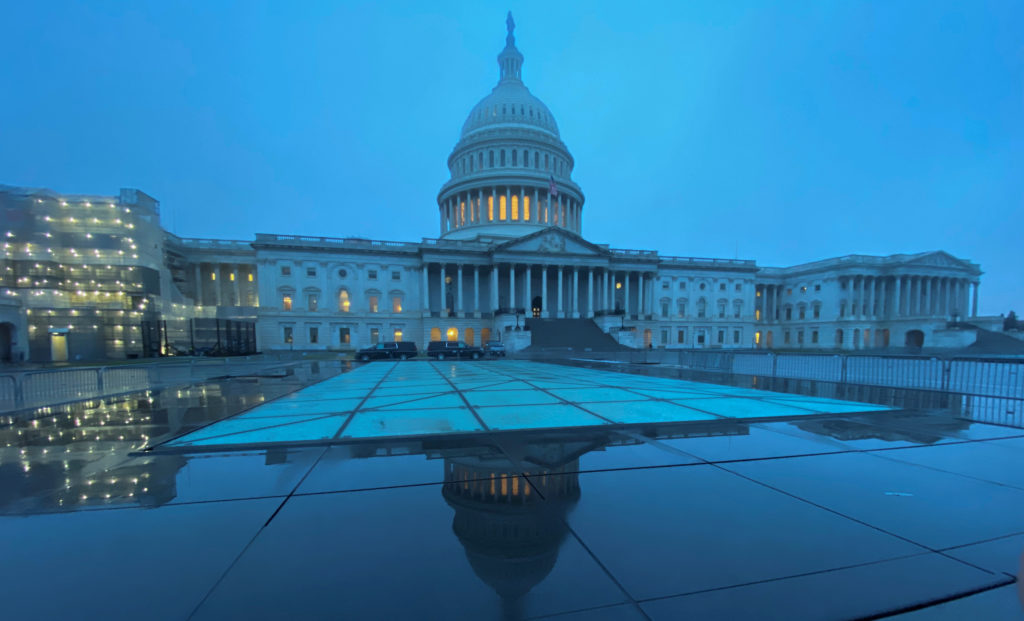 The U.S. Capitol dome is shrouded in early-morning mist in Washington, D.C. Photo by Jonathan Ernst/Reuters
