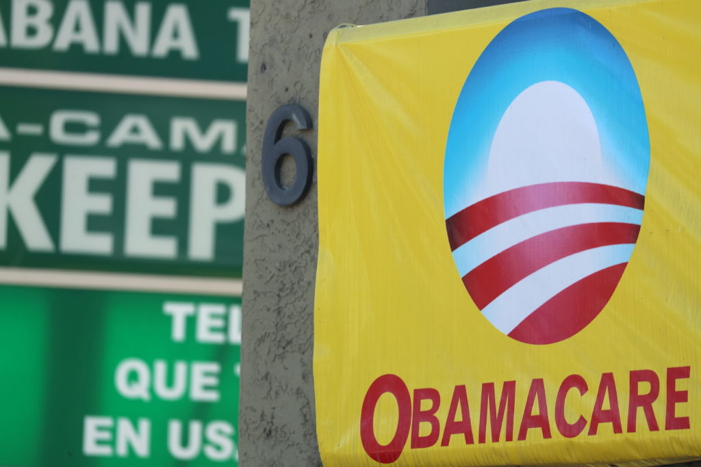 A sign on an insurance store advertises Obamacare in San Ysidro, San Diego, California, U.S., October 26, 2017. Photo by REUTERS/Mike Blake