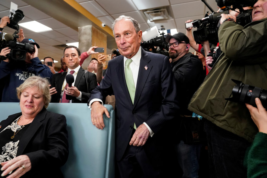 Former New York Mayor Michael Bloomberg arrives to speak with Virginia House Delegate-elect Nancy Guy after launching his ...