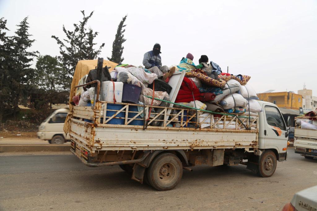 Trucks carry belongings of people fleeing from Maarat al-Numan, in northern Idlib, Syria December 24, 2019. Photo by REUTERS/Mahmoud Hassano