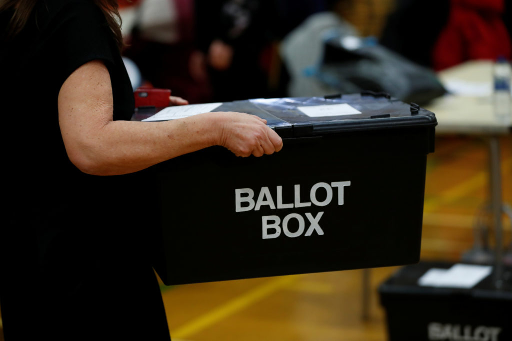 Ballots are delivered to a counting centre for Britain's general election in Hartlepool, Britain, December 12, 2019. Photo...