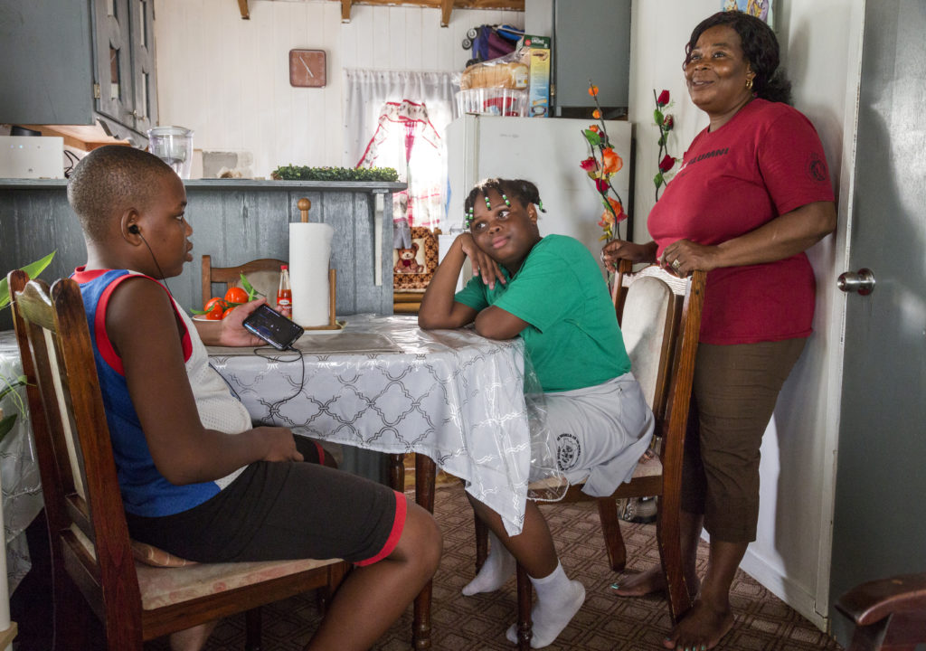 Corine Gerald spends time with her children, Jerrene, 11, and James Jr., 13, at the family's temporary home in St. John's, the capital of the island of Antigua on Nov. 7, 2019. Photo courtesy: UNICEF