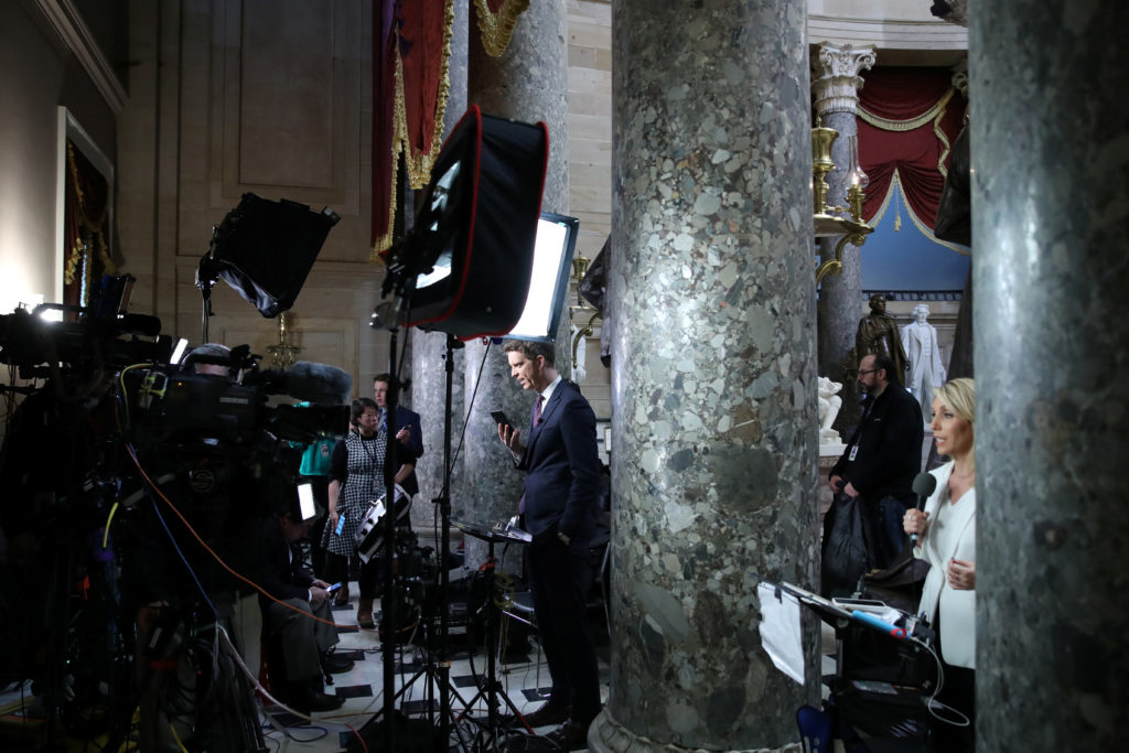Television reporters go live with developments in the vote to impeach U.S. President Donald Trump, near the House floor at the U.S. Capitol in Washington, U.S. December 18, 2019. Photo by REUTERS/Jonathan Ernst