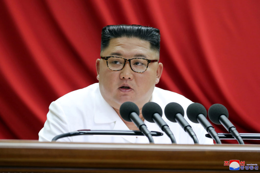 North Korean leader Kim Jong Un speaks during the 5th Plenary Meeting of the 7th Central Committee of the Workers' Party o...