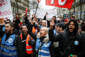 French labor union members and workers on strike attend a demonstration against the French government's pensions reform plans in Paris on December 28, 2019. Photo by Benoit Tessier/Reuters
