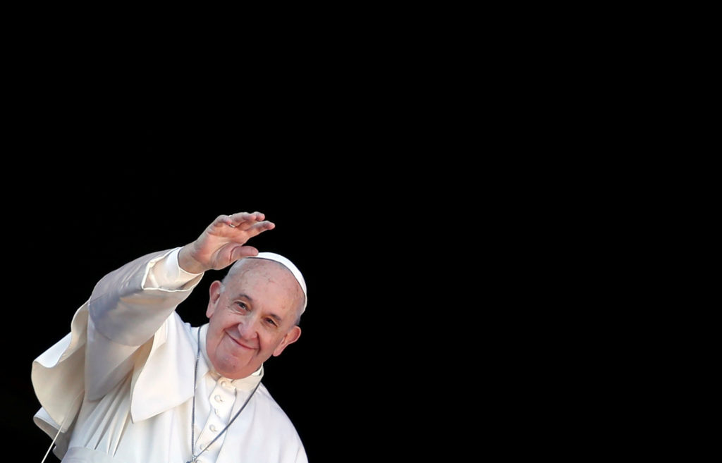 """Pope Francis waves as he delivers the """"Urbi et Orbi"""" Christmas Day message from the main balcony of St. Peter's Basilica at the Vatican, December 25, 2019. Photo by REUTERS/Yara Nardi"""