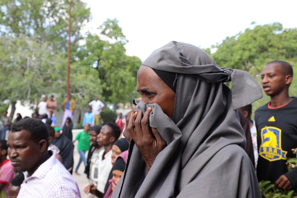A Somali woman reacts at the scene of a December 28 car bomb explosion in Mogadishu, Somalia. Photo by Feisal Omar/Reuters