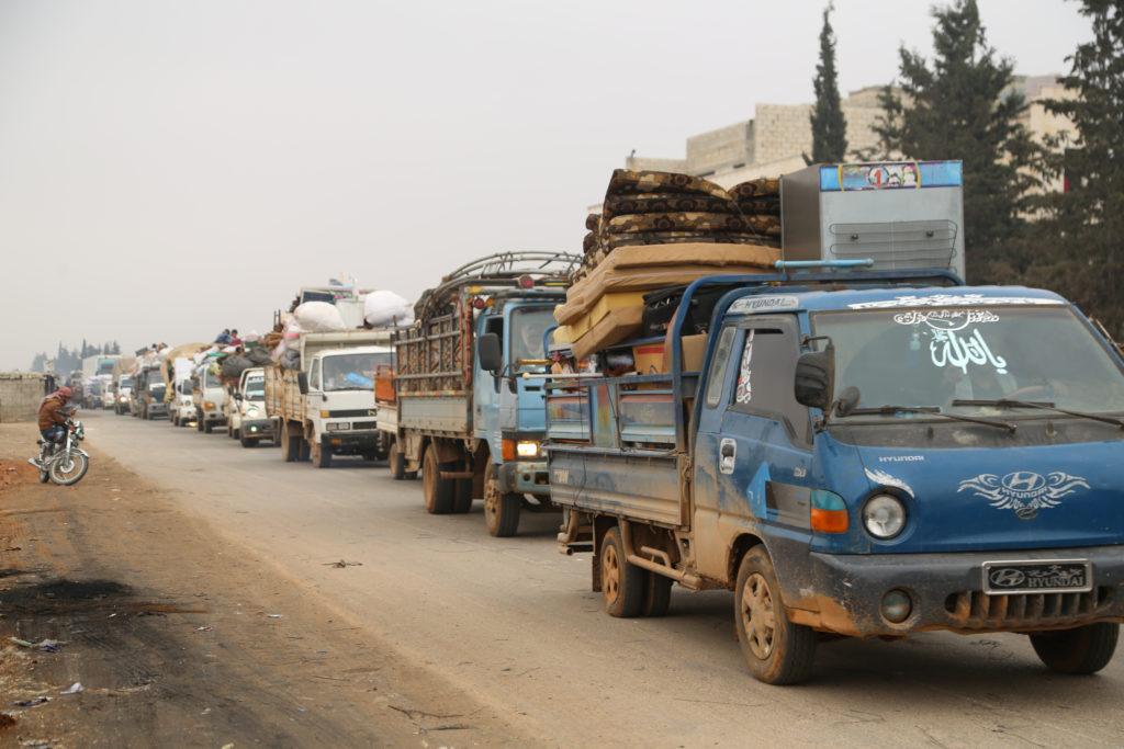 Trucks carry belongings of people fleeing from Maarat al-Numan, in northern Idlib, Syria December 24, 2019. Photo by REUTE...