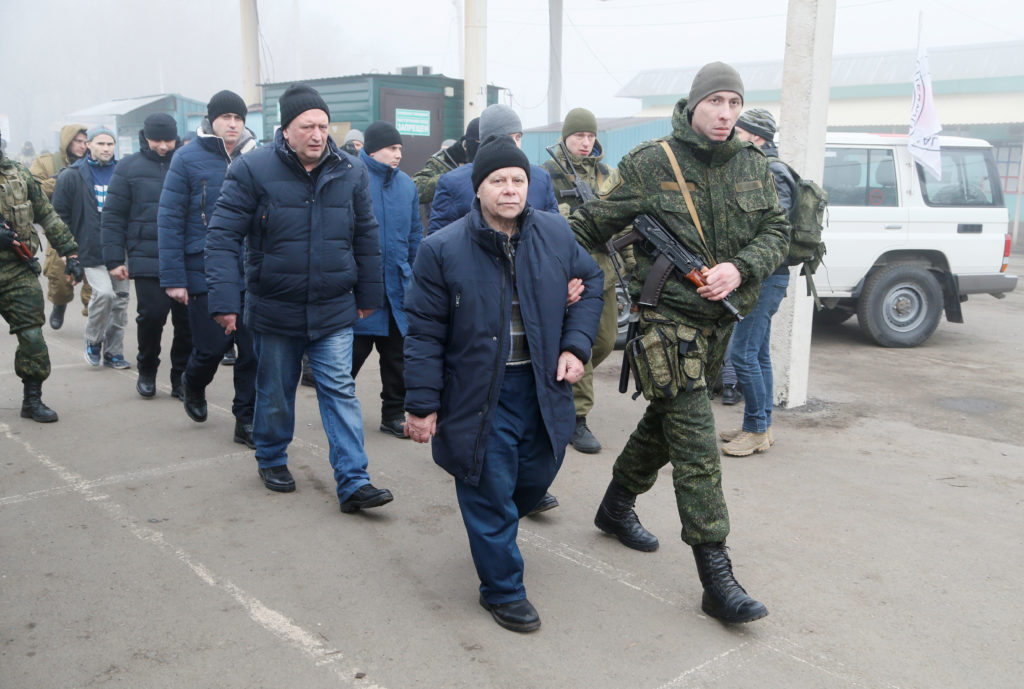 Men are escorted by servicemen of the self-proclaimed republics dur…