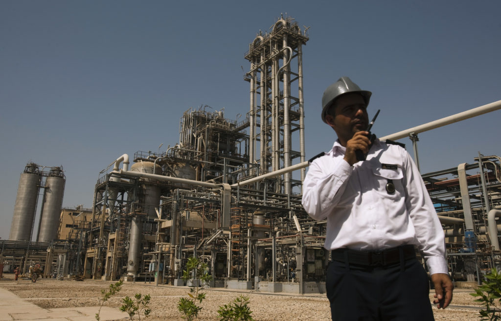 A security personnel stands in front of the Mahshahr petrochemical plant in Khuzestan province,1032 km (641 miles) southwe...