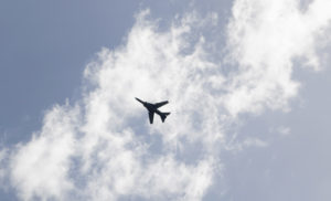 An airplane flies in the sky. Photo by Khalil Ashawi/Reuters
