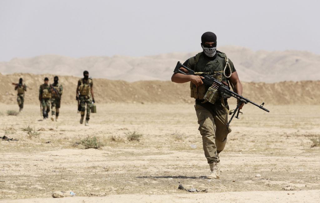 Asaib Ahl al-Haq Shi'ite militia fighters from the south of Iraq an…