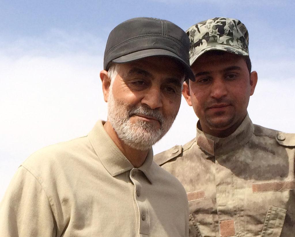 Iranian Revolutionary Guard Commander Qassem Soleimani (left) stand…