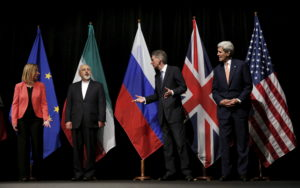 "British Foreign Secretary Philip Hammond (2nd R), U.S. Secretary of State John Kerry (R) and European Union High Representative for Foreign Affairs and Security Policy Federica Mogherini (L) talk to Iranian Foreign Minister Mohammad Javad Zarif as the wait for Russian Foreign Minister Sergey Lavrov (not pictured) for a group picture at the Vienna International Center in Vienna, Austria July 14, 2015. Iran and six major world powers reached a nuclear deal on Tuesday, capping more than a decade of on-off negotiations with an agreement that could potentially transform the Middle East, and which Israel called an ""historic surrender"". Photo by Carlos Barria/Reuters"