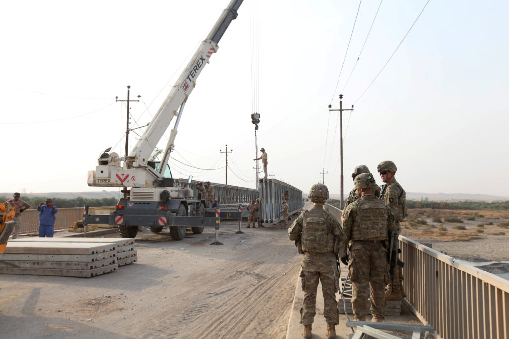 U.S. soldiers walk on a bridge in the town of Gwer, northern Iraq  August 31, 2016. U.S. forces have worked to improve Iraq's infrastructure since the 2003 invasion, but Iraq watchers say the efforts have done little to improve Iraq's economy. Photo by Azad Lashkari/Reuters