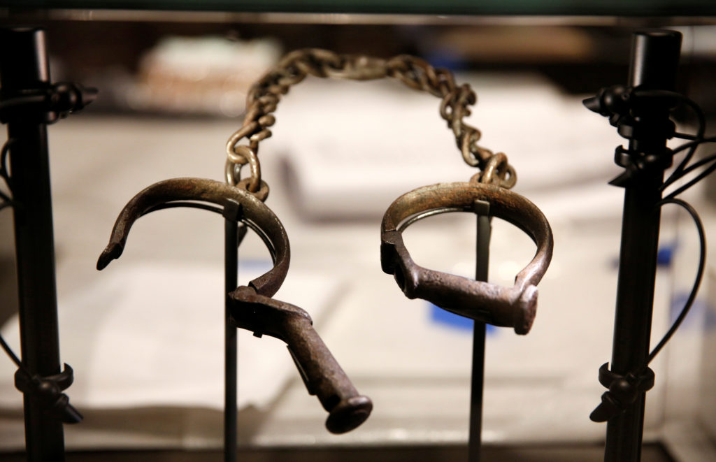 Slave shackles are seen in a display case during a media preview at the National Museum of African American History and Culture on the National Mall in Washington September 14, 2016. The museum will open to the public on September 24. Photo by Kevin Lamarque/Reuters
