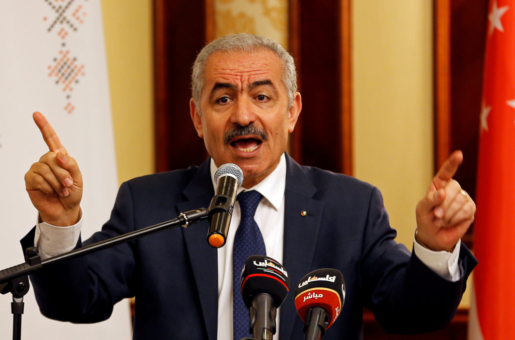 Palestinian Prime Minister Mohammad Shtayyeh gestures as he speaks during a workshop on cooperation between Palestinians and East Asian countries, in Jericho in the Israeli-occupied West Bank July 3, 2019. Photo by Mussa Qawasma/Reuters
