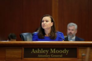 Attorney General Ashley Moody listens as Secretary of the Florida Department of Environmental Protection. Photo by Tori Schneider/Tallahassee Democrat via Imagn.