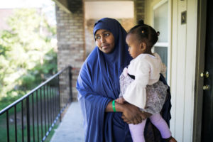 Ramlo Ali Noor, whose immediate family is affected by the Trump administration's cap on refugee numbers, poses at her apartment with her daughter Sumayo in Columbus, Ohio, U.S. September 27, 2019. Picture taken September 27, 2019. Photo by Maddie McGarvey/Reuters