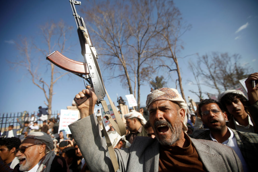 A man chants slogans as he and supporters of the Houthi movement attend a rally to celebrate following claims of military advances by the group near the borders with Saudi Arabia, in Sanaa, Yemen October 4, 2019. Photo by Mohamed al-Sayaghi/Reuters