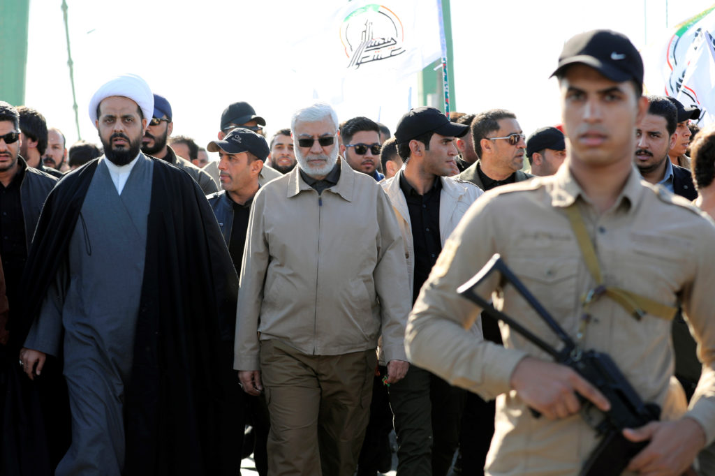 Qais al-Khazali, leader of the militant group Asaib Ahl al-Haq, and Abu Mahdi al-Muhandis, a commander in the Popular Mobilization Forces attend a funeral procession of Hashd al-Shaabi (paramilitary forces) members, who were killed by U.S. air strikes in Qaim district, at the Green zone in Baghdad, Iraq December 31, 2019. Photo by Thaier al-Sudani/Reuters