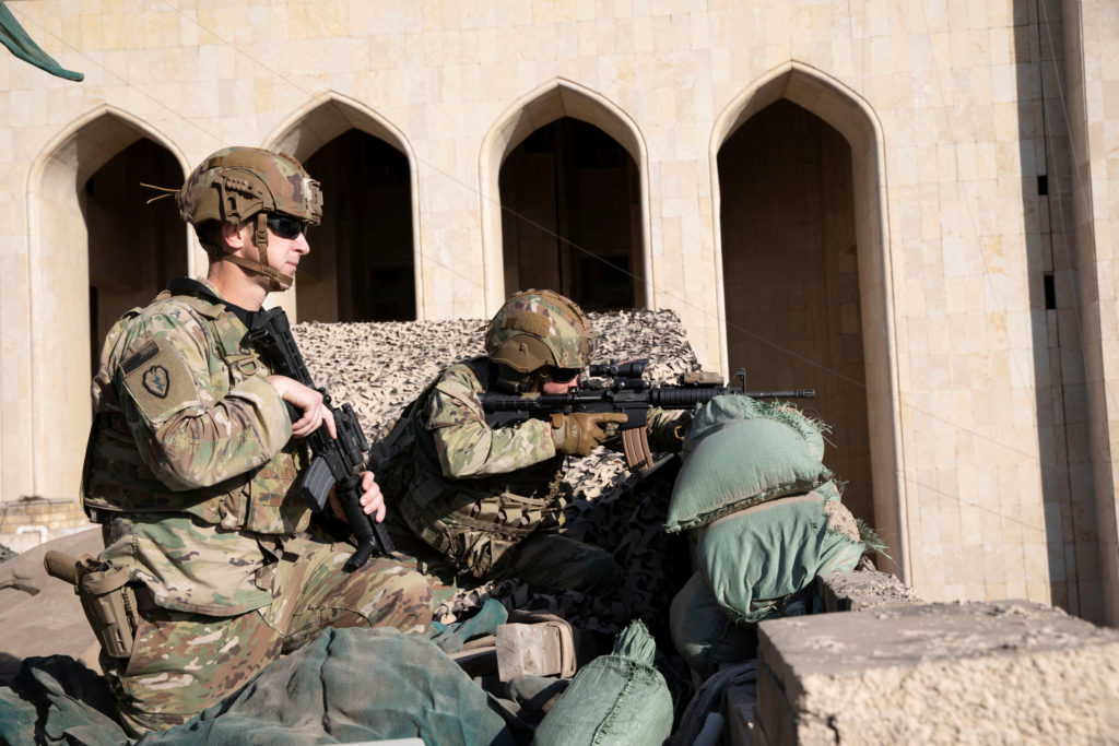 U.S. Army soldiers from 1st Brigade, 25th Infantry Division, Task Force-Iraq, man a defensive position at Forward Operating Base Union III in Baghdad, Iraq, December 31, 2019. U.S. Army/Maj. Charlie Dietz/Task Force-Iraq Public Affairs/Handout via Reuters