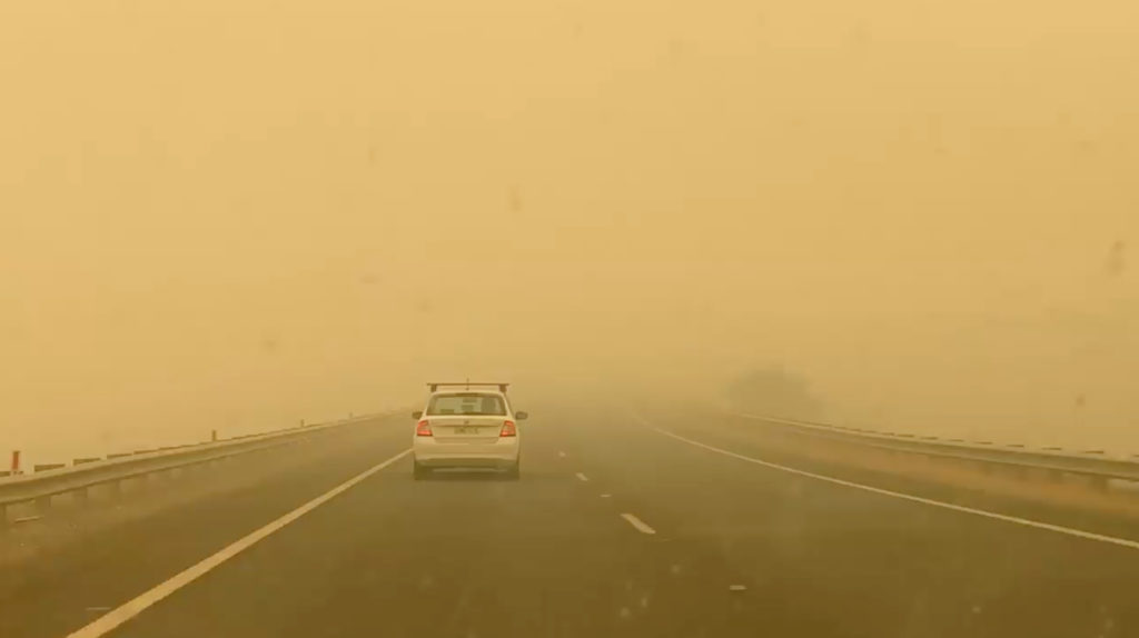 A car drives in smog on the road to Cooma from Canberra in Bredbo, Australia January 1, 2020, in this picture obtained from social media video. LINSAY PATTERSON/via REUTERS