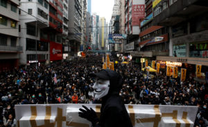 An anti-government protester wears a Guy Fawkes mask during a demonstration on New Year's Day to call for better governance and democratic reforms in Hong Kong, China, January 1, 2020. Photo by Navesh Chitrakar/Reuters