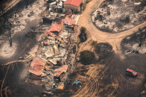 Property damaged by the East Gippsland fires in Sarsfield, Victoria, Australia January 1, 2020. AAP Image/News Corp Pool, Jason Edwards/via Reuters
