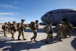 U.S. Army paratroopers of an immediate reaction force from the 2nd Battalion, 504th Parachute Infantry Regiment, 1st Brigade Combat Team, 82nd Airborne Division, board their C-17 transport aircraft as they leave Fort Bragg, North Carolina, U.S. January 1, 2020. Photo by Jonathan Drake/Reuters