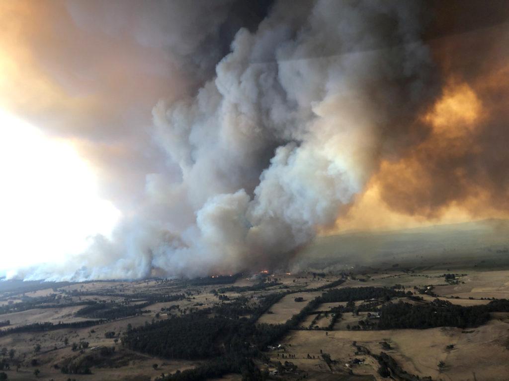 Smoke billows during bushfires in Buchan, Victoria, Australia, Dece…