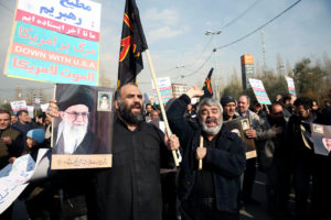 Demonstrators react during a protest against the assassination of the Iranian Major-General Qassem Soleimani, head of the elite Quds Force, and Iraqi militia commander Abu Mahdi al-Muhandis who were killed in an air strike in Baghdad airport, in Tehran, Iran January 3, 2020. WANA (West Asia News Agency)/Nazanin Tabatabaee via Reuters