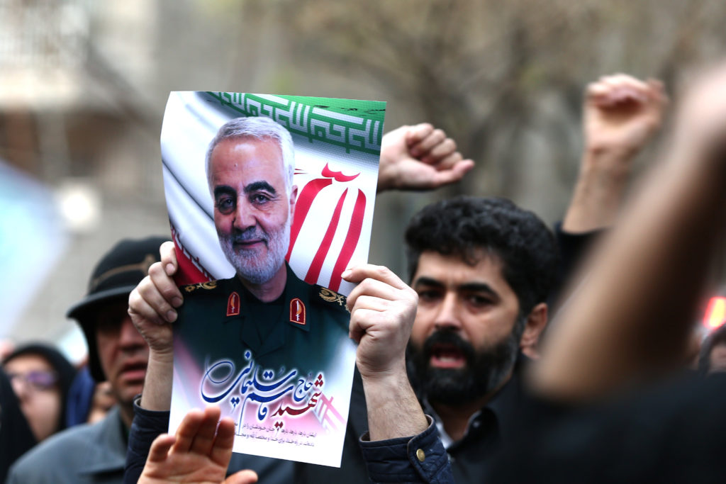 Iranian demonstrators chant slogans during a protest against the assassination of the Iranian Major-General Qassem Soleima...