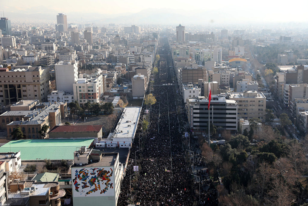 Iranian people attend a funeral procession for Iranian Major-General Qassem Soleimani, head of the elite Quds Force, and Iraqi militia commander Abu Mahdi al-Muhandis, who were killed in an air strike at Baghdad airport, in Tehran, Iran January 6, 2020. Official Khamenei website/Handout via Reuters