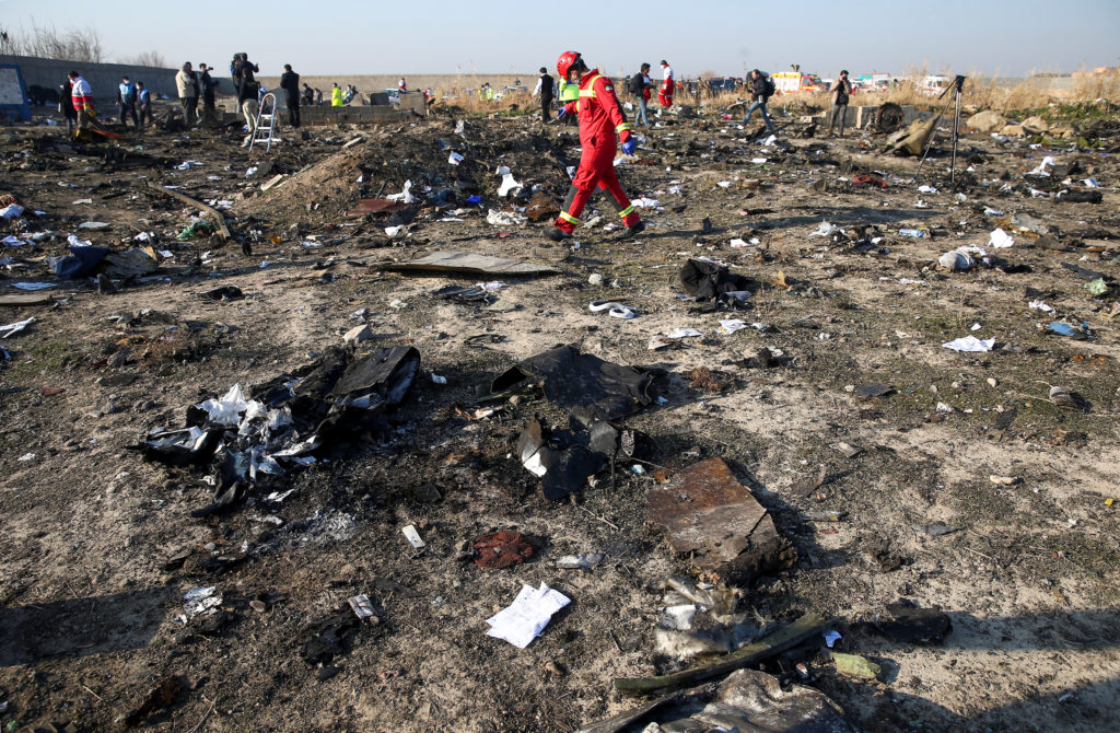 A member of a rescue team walks among debris from a plane belonging to Ukraine International Airlines, that crashed after a take-off from Iran's Imam Khomeini airport, on the outskirts of Tehran, Iran January 8, 2020. Photo by Nazanin Tabatabaee/WANA (West Asia News Agency) via Reuters