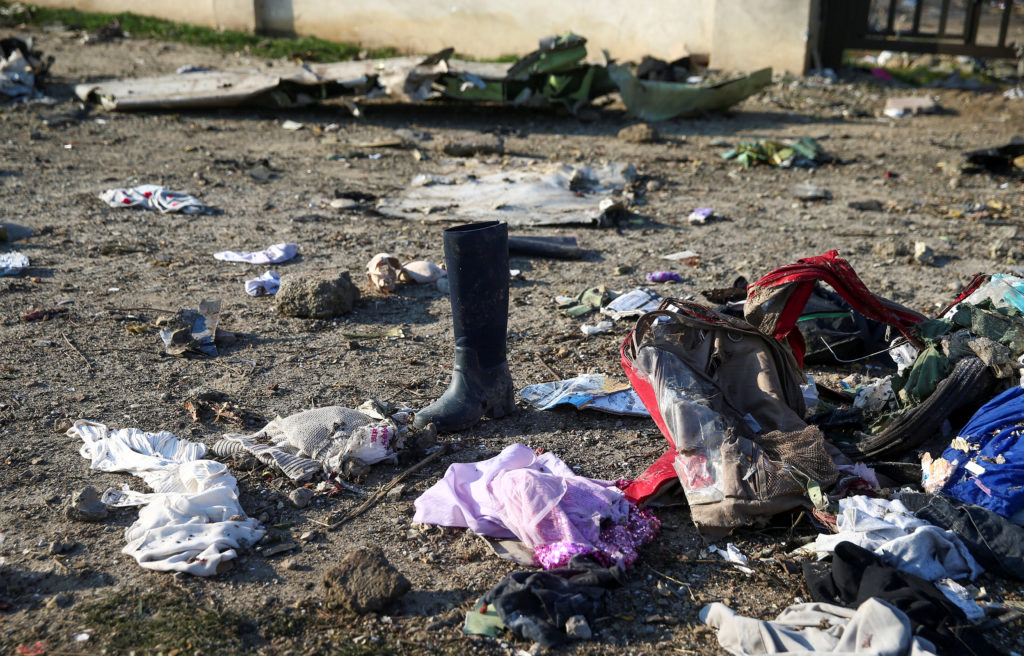 Passengers' belongings are pictured at the site where the Ukraine International Airlines plane crashed after take-off from Iran's Imam Khomeini airport, on the outskirts of Tehran, Iran January 8, 2020. Photo by Nazanin Tabatabaee/WANA (West Asia News Agency) via Reuters