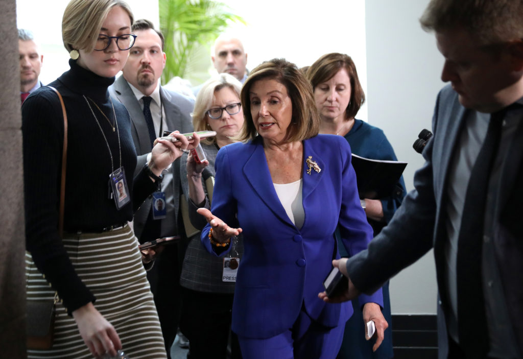 U.S. House Speaker Nancy Pelosi answers questions from reporters after leaving a House Democratic caucus meeting on Capitol Hill in Washington, U.S., January 8, 2020. Photo by Leah Millis/Reuters