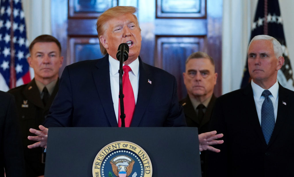 President Donald Trump delivers a statement about Iran flanked by U.S. Army Chief of Staff General James McConville, Chairman of the Joint Chiefs of Staff Army General Mark Milley and Vice President Mike Pence in the Grand Foyer at the White House on Jan. 8, 2020. Photo by REUTERS/Kevin Lamarque