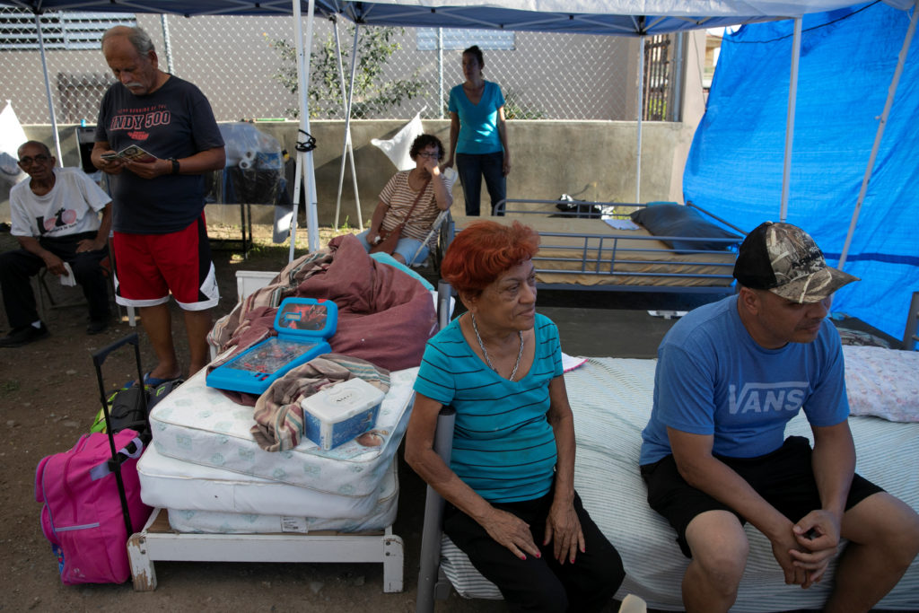 People rest at a camp set up in a lot next to their homes after the earthquake in Yauco, Puerto Rico, January 9, 2020. Photo by Marco Bello/Reuters