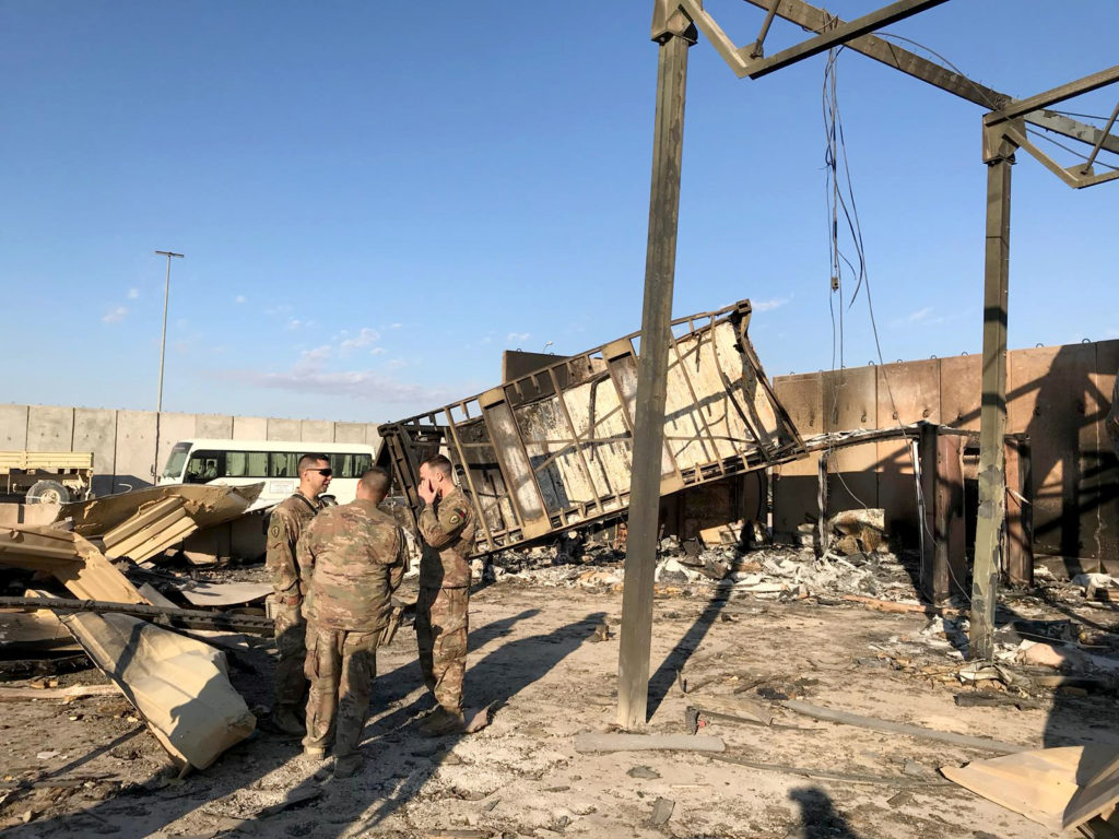 U.S. soldiers are seen at the site where an Iranian missile hit at Ain al-Asad air base in Anbar province, Iraq January 13, 2020. Photo by John Davison/Reuters