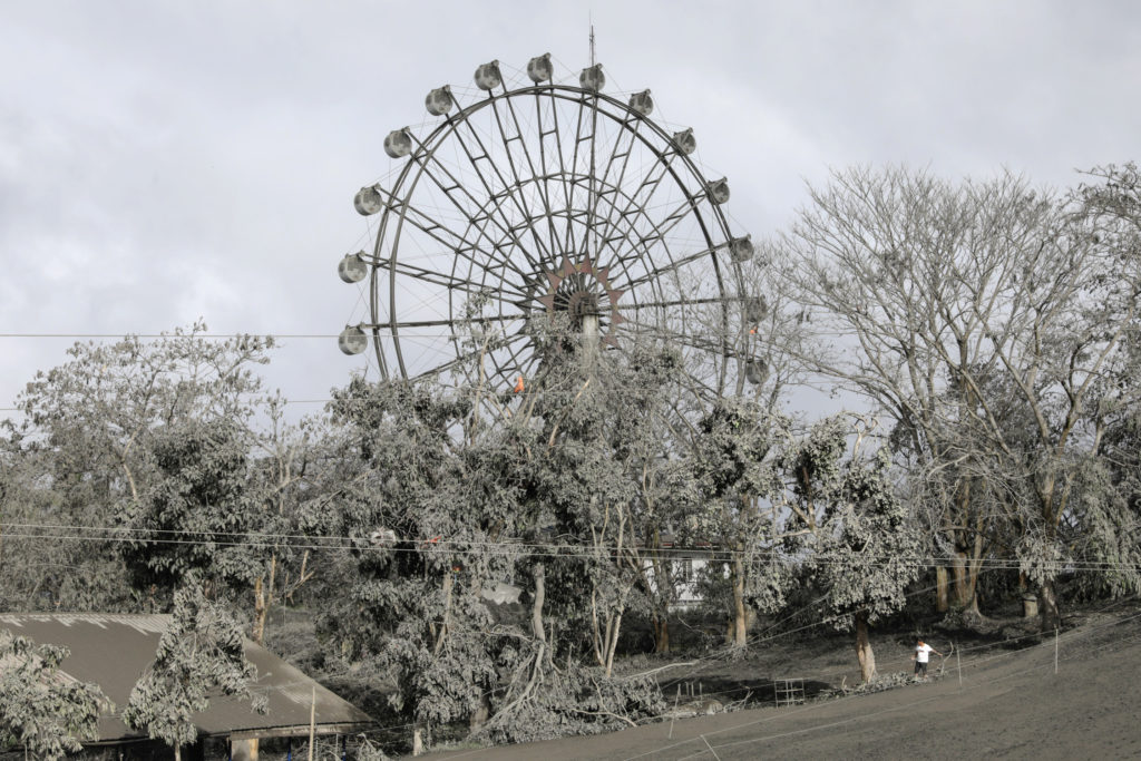 A ferris wheel is covered with volcanic ash in a park in Tagaytay City, Philippines, January 14, 2020. Photo by Eloisa Lopez/Reuters