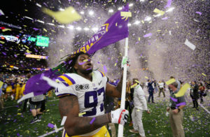 LSU Tigers defensive end Glen Logan (97) celebrates after the LSU Tigers defeated the Clemson Tigers in the College Football Playoff national championship game at Mercedes-Benz Superdome. Mandatory Credit: Derick E. Hingle-USA TODAY Sports