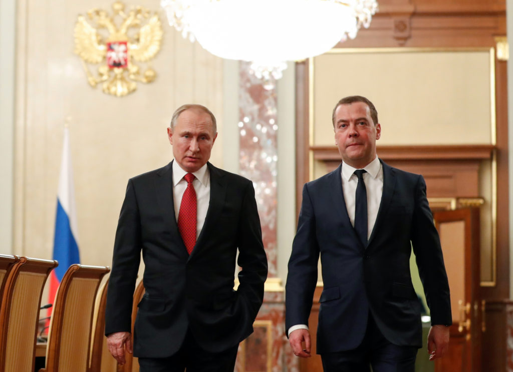 Russian President Vladimir Putin and Prime Minister Dmitry Medvedev speak before a meeting with members of the government in Moscow, Russia January 15, 2020. Sputnik/Dmitry Astakhov/Pool via REUTERS