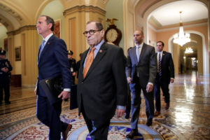 House impeachment managers, including lead manager House Intelligence Committee Chairman Adam Schiff (D-CA); Judiciary Committee Chairman Jerrold Nadler (D-NY); House Democratic Caucus Chairman Hakeem Jeffries (D-NY) and Rep. Jason Crow (D-CO), walk through the Ohio Clock Corridor as they arrive for the procedural start of the Senate impeachment trial of U.S. President Donald Trump in the U.S. Capitol in Washington, U.S., January 16, 2020. Photo by Jonathan Ernst/Reuters