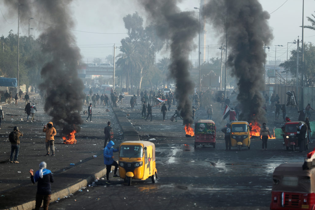 Iraqi demonstrators burn tires during ongoing anti-government protests in Baghdad, Iraq January 20, 2020. Photo by Thaier al-SudanI/Reuters